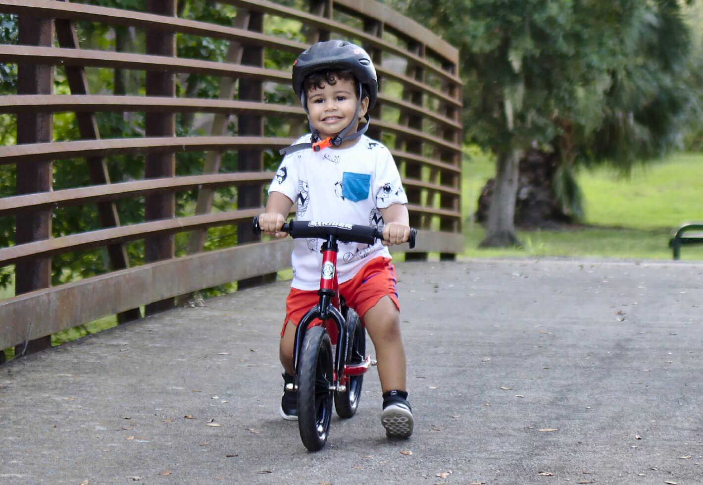 Child on a Strider 12 Balance Bike